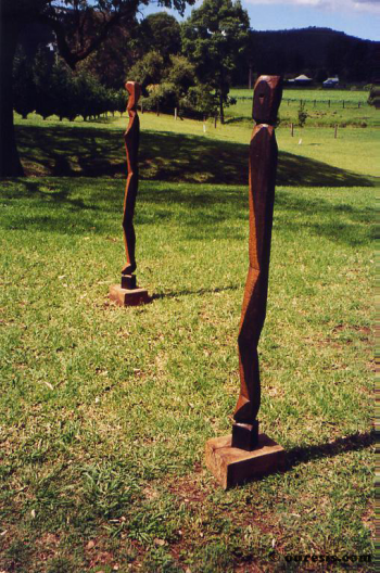 Eve and Adam, hardwood. Photograph from a public group exhibition entitled Sculpture in the Vines, Hunter Valley Harvest Festival, New South Wales, Australia 2003.